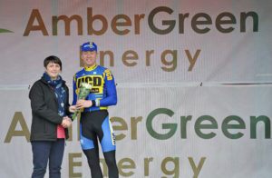 30th of April, 2016; Paula Nugent, left, with third placed rider on the stage Eoin Morton, UCD FitzCycles, on the awards podium at the finish of Stage 1 of the AmberGreen Energy Tour of Ulster. Moy, Co. Tyrone. Picture credit: Stephen McMahon / Tour of Ulster