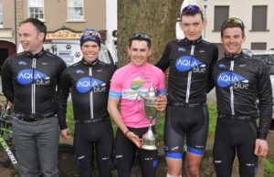 2nd of May, 2016; Overall race winner Conor Hennebry, Team Aquablue, in pink, pictured with teammates and support staff at the finish of Stage 3 of the AmberGreen Energy Tour of Ulster. Moy, Co. Tyrone. Picture credit: Stephen McMahon / Tour of Ulster