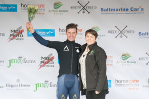29th of April, 2017; Matteo Cigala, Aqua Blue Sport Academ, centre, receives the award for second place from Paula Nugent, Tour of Ulster, right, on the awards podium on Stage 1 of the AmberGreen Energy Tour of Ulster. Moy, Co. Tyrone. Picture credit: Stephen McMahon / Tour of Ulster