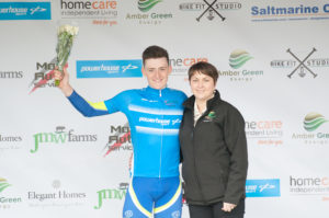 29th of April, 2017; Dermot Trulock, Stagg Cycles Lucan Cycling Road Club, receives the blue jersey of King of the Mountains from Paula Nugent, Tour of Ulster, on the awards podium at the finish of Stage 1 of the AmberGreen Energy Tour of Ulster. Moy, Co. Tyrone. Picture credit: Stephen McMahon / Tour of Ulster